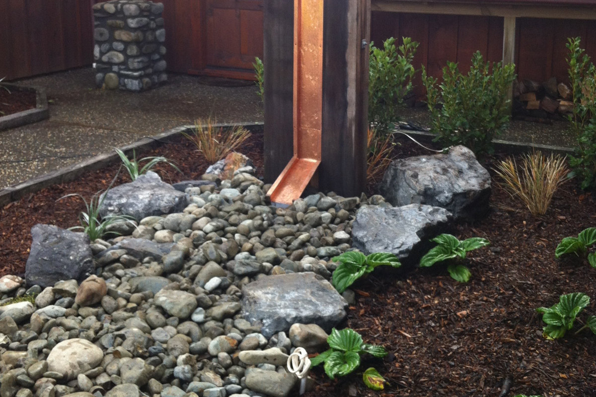 Total Landscape Solutions Construction Water feature and planting